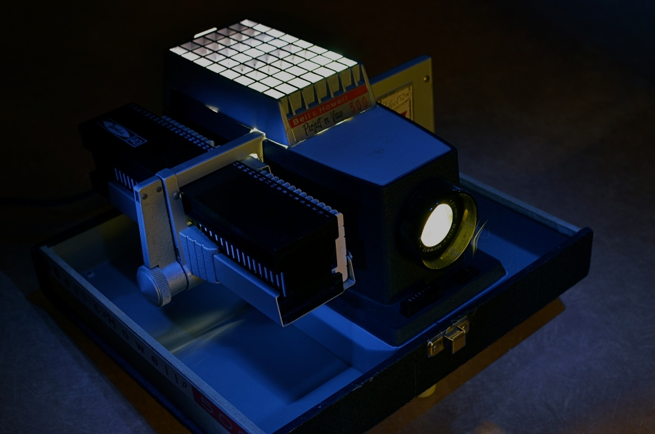 Magic in the darkness: my family's Bell& Howell 500 projector. 10 sec., f/5.6, ISO 100, 35mm.