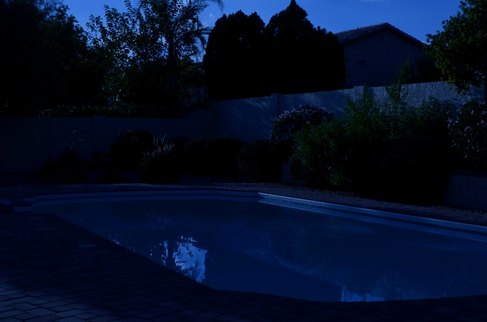 "Moonlight night around the poolside, only not really: a ""day-for-night"" shot taken at 5:17pm. 1/400 sec., f/18, ISO 100, 35mm."