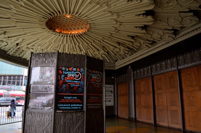 The Wiltern's ticket kiosk sits under a plaster canopy of Deco sunrays. 1/40 sec., f/3.5, ISO 100, 18mm.