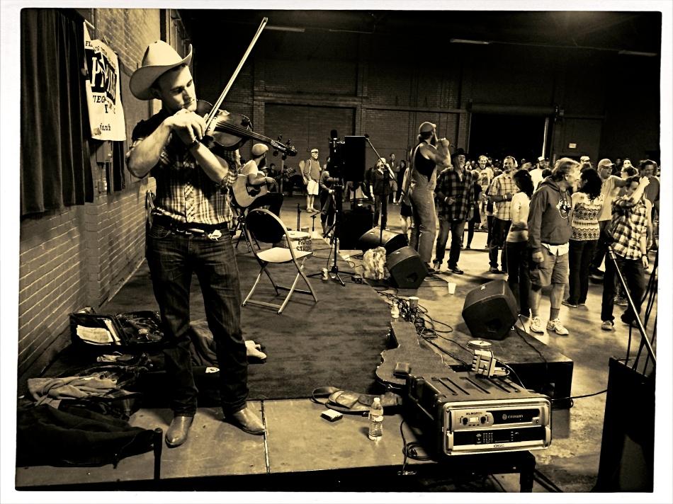 Tuning up: A fiddler runs a few practice riffs before a barn dance in Flagstaff, Arizona.
