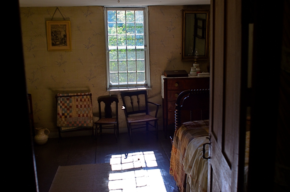 A sunlit bedroom at the Old Manse, the farm home built for the grandfather of Ralph Waldo Emerson.