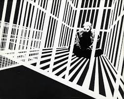 Cartoonist Frank Miller sculpts solid space out of a mix of black and white rays.
