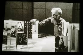 Edward Steichen looks over a scale model of the 1955 Family Of Man show, the most famous photographic exhibit of all time.