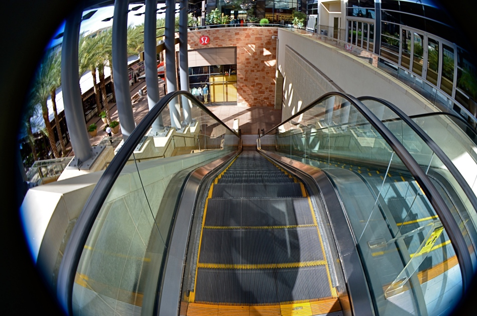 This mall escalator is nowhere near as high as a 13mm fisheye lens makes it appear.