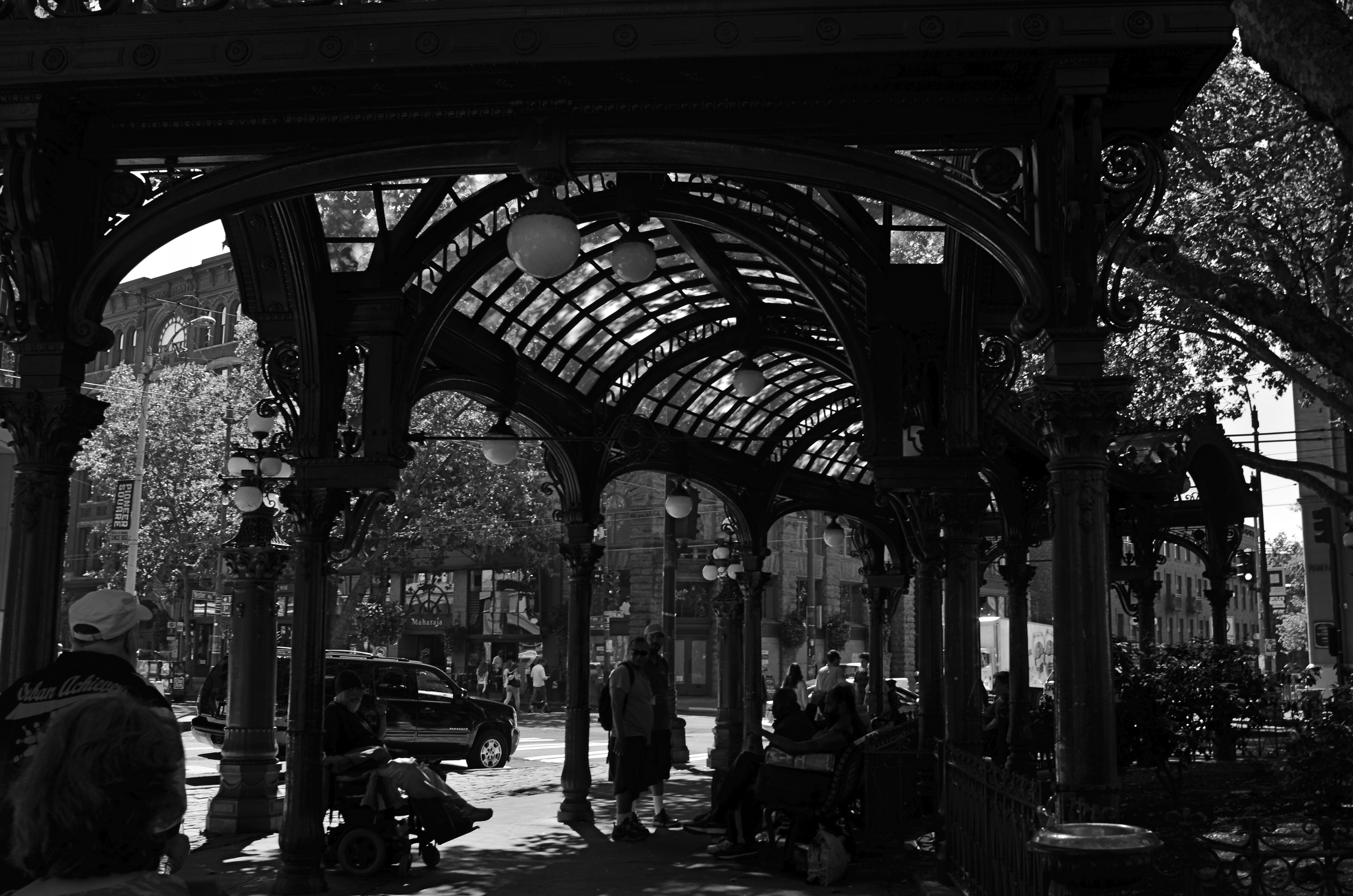 Local characters convene under an aging arch in downtown Seattle.